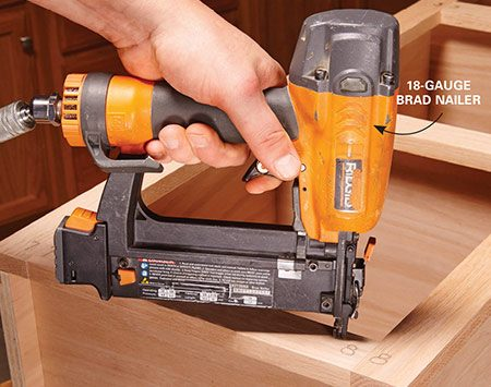 <b>Simple attachment method</b></br> <p>One of the easiest ways to attach face frames to carcasses is with a thin bead of wood glue and an 18-gauge brad nailer with 2-in. brads. Be sparing with brads; their main duty is to hold the frame in place while the glue dries. A couple per side and wherever there's a void should do the trick. A little putty will make the brad holes almost invisible.</p>