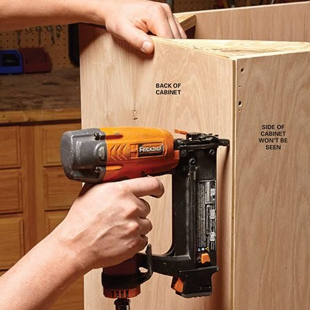 <b>Time saver</b></br> <p>It's common practice to cut a rabbet (a notch to receive the 1/4-in. back panel) on the back edge of cabinet carcasses so the back panel will be recessed. But that's not necessary if the cabinet sides won't be visible—the back panel edges won't be either. Save yourself some time and just tack on the back panel with a brad nailer. Make sure to take into account the overall depth of your cabinets—they'll be 1/4 in. deeper if you go this route.</p>