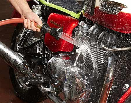 <b>Photo 7: Do a full rinse</b></br> <p>Rinse again with water and blast off the final rinse with a blower or compressed air. Wipe off any remaining water drops to prevent spotting.</p>