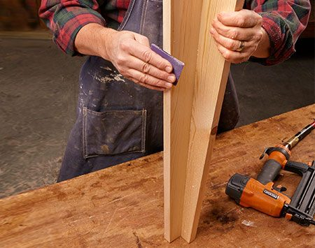 <b>Assemble the leg</b></br> <p>Glue and nail (or screw) the two pieces together, then sand as much as you feel is necessary.</p>