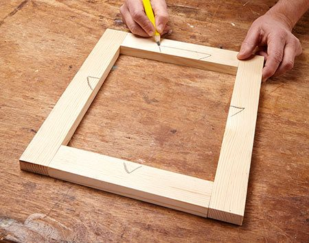 Drawing parts of a triangle on a frame to help keep them in the proper order when assembling.