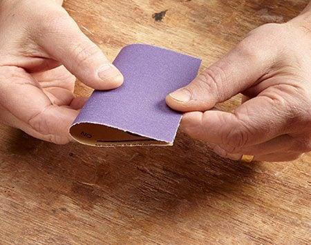 <b>Photo 1: Fold the sandpaper in half</b></br>