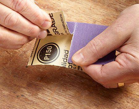 <b>Photo 3: Tear back the sandpaper halfway along a crease</b></br>