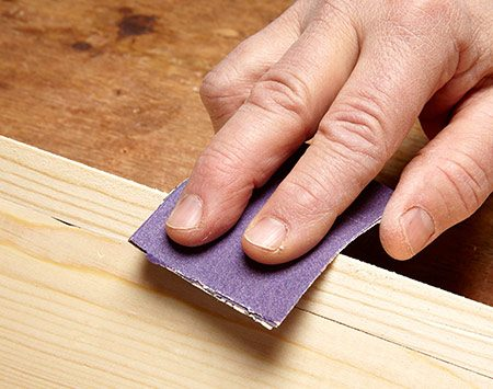 Sanding with a sandpaper pad.