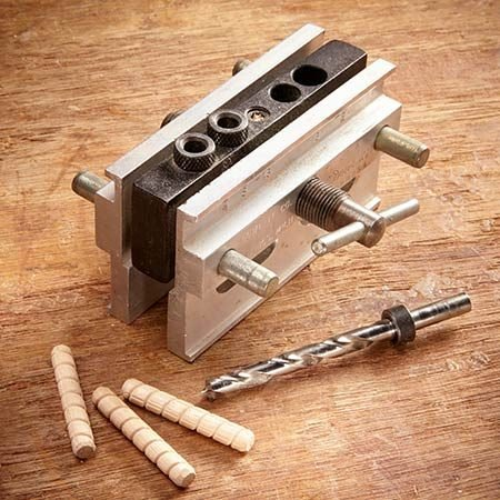 <b>Self-centering dowel jig</b></br> <p>Use a self-centering dowel jig like this classic model from Dowl-it.</p>