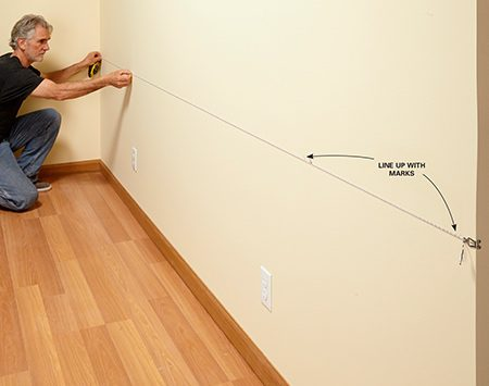 <b>Photo 2: Snap a line</b></br> <p>Line up a chalk line with the two marks and snap a line.</p>
