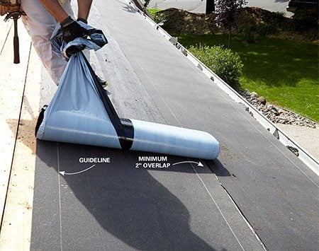 <b>Stick the bottom part of the underlayment to the roof of the house.</b></br> <p>Install the second course just like the first, using the guidelines on the underlayment to get the correct overlap.</p>