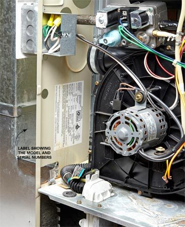 <b>Photo 1: Find model and serial numbers</b></br> <p>Yank off the furnace covers and inspect the side panels in the burner area to find the manufacturer's label. Write down (or shoot a cell phone photo) of the model number, serial number and date of manufacture.</p>