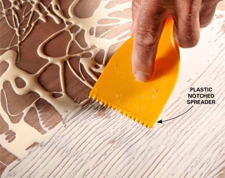 <b>Get better coverage on large pieces</b><br/><p> When you&rsquo;re gluing large surfaces, an inexpensive notched plastic trowel works great for spreading the glue. To find one, look in the flooring or tile section of the hardware store or home center. If you&rsquo;re fortunate enough to have a &ldquo;pinking&rdquo; shears in the family sewing basket, you can make our own spreader from an expired credit card.</p>