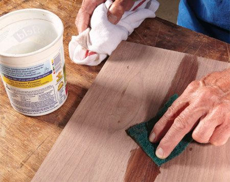 <b>Scrub off squeeze-out</b><br/><p> It can be difficult to remove excess glue with a rag. And if you don&rsquo;t get it all off the surface when it&rsquo;s wet, the dried glue can show up as light spots when you finish your project. But a synthetic abrasive pad, dampened with water, works perfectly to remove the glue.  Unlike a rag, which is hard to rinse glue from, the pad releases glue easily. Wet the pad and shake it to remove most of the water. Then scrub off excess glue. When you&rsquo;re done, dry the surface with a clean rag.</p>