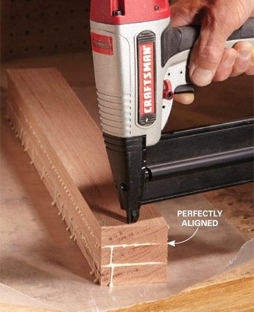 <b>Keep boards in place with brad nails</b><br/><p> Wood glue makes boards slippery, so it can be hard to keep them lined up correctly while you apply clamps. An easy solution is to hold the parts in alignment with a few strategically placed brads before you apply the clamps. For leg glue-ups like we show here, cut your parts extra long and place the brads where they&rsquo;ll get cut off during the finishing process. Otherwise, just place brads where the filled holes won&rsquo;t be too visible.</p>