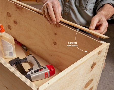 "<b>Photo 3: Cover the plywood edges</b></br> <p>Install screen molding over the front edges of the box. Apply wood glue lightly and use just enough nails to ""clamp"" the molding in place while the glue dries.</p>"