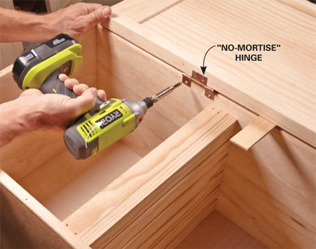 <b>Photo 6: Mount the hinges</b></br> <p>Remove the hinges from the doors (they'll be pointed the wrong way) and reinstall them on the door based on the direction you want it to swing. Prop up the door alongside the box and align the door so there will be a 1/8-in. gap at the top and bottom of the box. Then screw the hinges to the box.</p>
