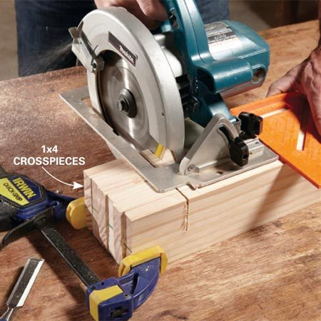 <b>Gang-cutting the pieces</b></br> <p>Clamp the 1x4s together and gang-cut the notches.</p>