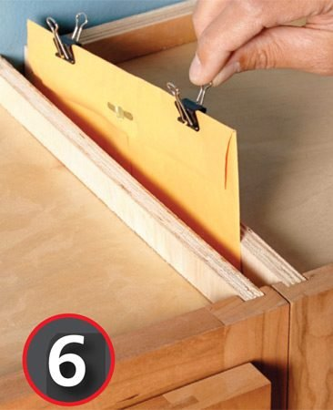 Make a secret hiding place between cabinets.