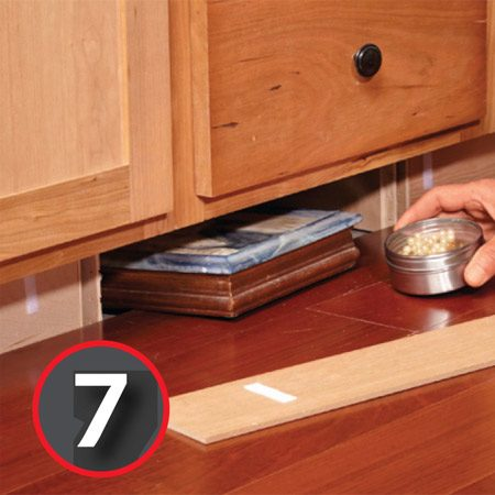 Create a secret compartment under your cabinets.