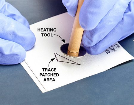 <b>Photo 2: Cure the patch with heat</b><br/><p> Touch the heating tool (included with the kit) to the face of a hot clothes iron. Then press the hot tool onto the textured mat and hold it in place.</p>