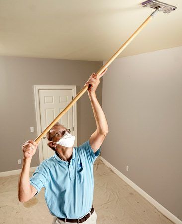 Lightly sand and wipe before you start painting the ceiling.