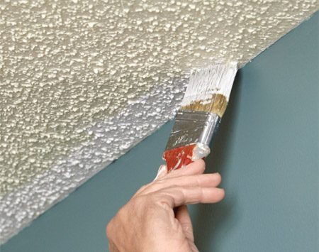 Start painting the ceiling by cutting in a section at a time.