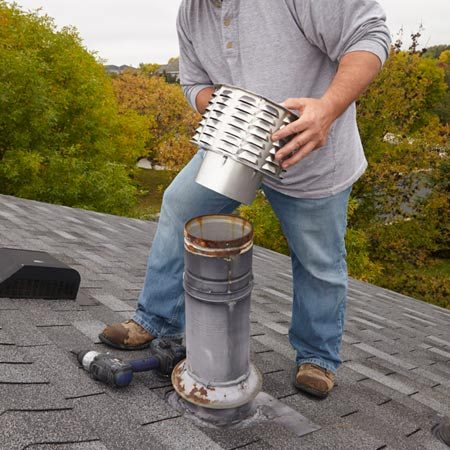 <b>Photo 1: Check and adjust the fit</b></br> <p>Slide the new cap into the flue. If the stub section on the cap is too large, crimp it with a crimping tool.</p>