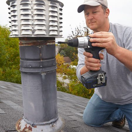 <b>Photo 2: Level and secure the cap</b></br> <p>Plumb the cap so it fits squarely in the flue and secure it with one sheet metal screw. Recheck that the cap is plumb and install two more screws.</p>
