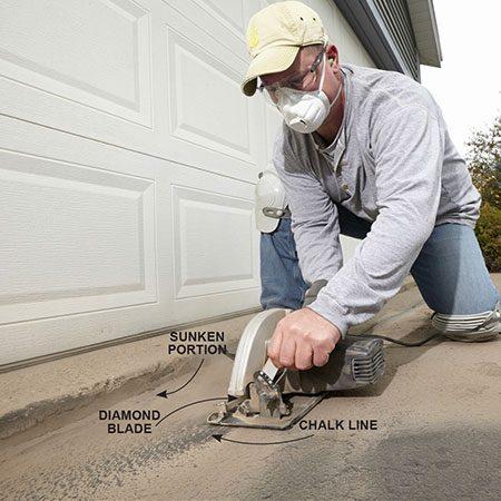 <b>Photo 1: Cut out the sunken asphalt</b></br> <p>Slap a diamond blade into your circular saw and set it to its maximum cutting depth. Then snap a chalk line out from the garage floor to a maximum distance of 24 in. Wear an N95 respirator and safety glasses and cut out the old asphalt.</p>
