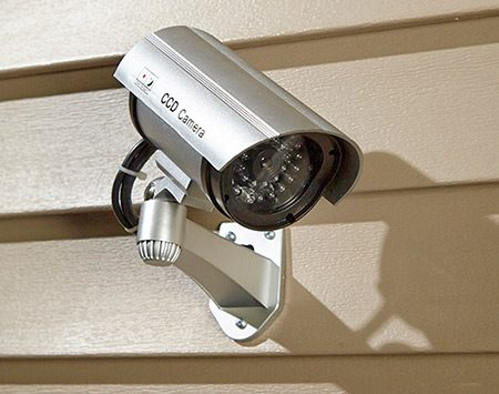 <b>Real or fake?</b></br> <p>Place video cameras by doors and windows. Most burglars won't take the time to figure out if the camera is real—they'll just avoid the house.</p>