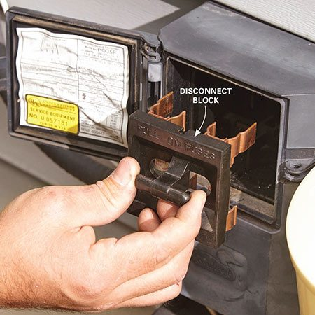 <b>Photo 1: Shut off the power</b></br> <p>Open the electrical box next to the condensing unit and pull the disconnect block straight out. Check inside the box with a voltage sniffer to make sure the power is really off.</p>