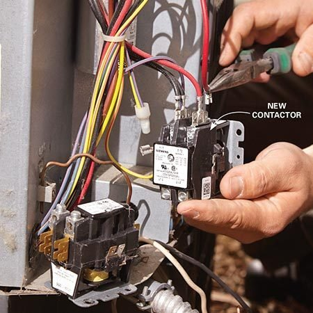 <b>Photo 6: Swap out the contactor</b></br> <p>Yank a connector off the old contactor and move it to the same location on the new part. Tighten the connectors where needed. Then secure the new contactor in the condensing unit.</p>