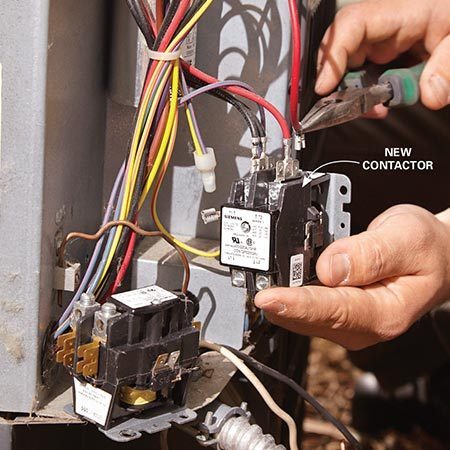 <b>Photo 6: Swap out the contactor</b><br/><p>Yank a connector off the old contactor and move it to the same location on the new part. Tighten the connectors where needed. Then secure the new contactor in the condensing unit.</p>