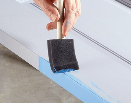 <b>Photo 5: Paint the edges and wipe off the slop</b></br> <p>Brush or roll paint onto all four edges. Immediately wipe any paint that slops onto the face of the door with a rag or foam brush. You don't have to completely remove the paint, but you do have to flatten it to prevent ridges.</p>