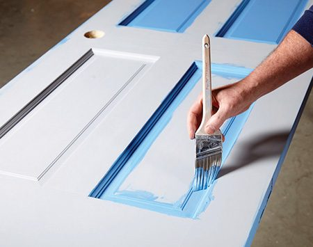 <b>Photo 6: Brush around the panels</b></br> <p>Work the paint into the corners and grooves, then drag the brush over the paint to smooth it. Wipe away any slop around the panel as shown in<br />Photo 5.</p>