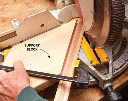 <b>Solution: Clamp to an angled block</b></br>   Cut a block of wood at a 45-degree angle and cut a flat spot for the clamp. Clamp the molding to the block and line up the miter saw with the mark to make the cut.