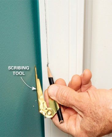 <b>Solution: Step 1 – Scribe a line on the casing</b></br> <p>Set the  scribing tool to the distance between the wall and the   mark on  the casing. Scribe a line by running the point of the   tool  against the wall, being careful to keep the tool perpendicular to the wall. </p>