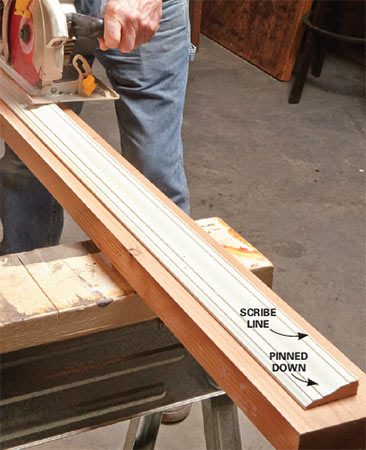 <b>Solution: Step 2 – Cut along the lines</b></br> <p> Next, remove the molding and tack it to a  board. Carefully   saw along  the line with your circular saw. Stay a little outside   the line.  Then finish up by belt-sanding   or  planing up to the line. </p>