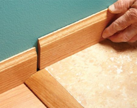 <b>Problem: Moldings don't line up</b></br>  A change in floor heights creates an ugly jog in the baseboard.