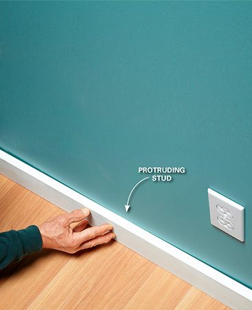 <b>Problem: A hump causes baseboard gaps</b></br>  Even if we could draw the baseboard tight to the wall on both sides of this hump, the baseboard would still look wavy. It's better to get rid of the hump.