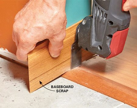 <b>Solution: Notch them with an oscillating tool.</b></br>  Mount a fine-tooth blade in the oscillating tool. Then use a scrap of baseboard as a guide to cut the wood transition.