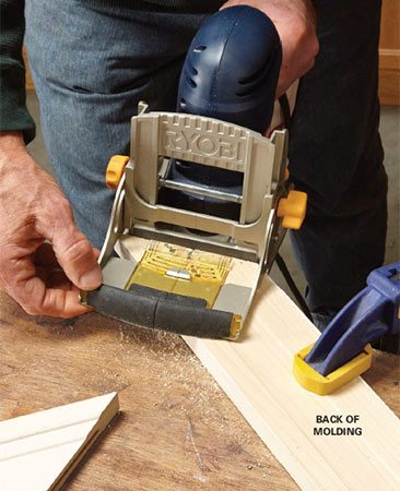 <b>Solution: Step 1 – Cut biscuit slots</b></br> Clamp the molding (face down if it has a profile) and cut a slot with the biscuit joiner. Cut a biscuit slot in the same location on the other molding.