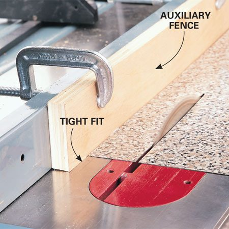 <b>Fence for cutting laminate</b></br> <p>An auxiliary fence mounted tightly against the table is essential when cutting plastic laminate (or any other thin material) on a table saw. Without it, skinny stuff can slip under the fence and cause a crooked cut, major chipping, kickback and injury, and ruin an expensive sheet of laminate.</p>