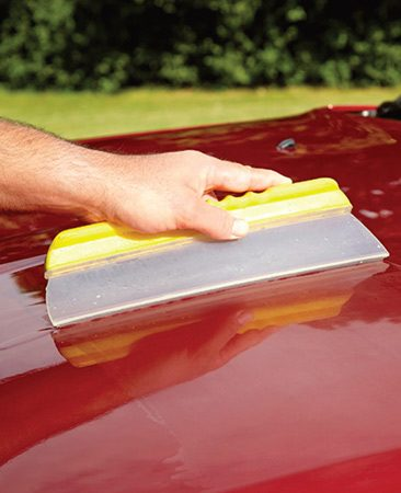 <b>Dry the vehicle</b><br/><p>Swipe the water off with a water blade squeegee. It will dry the surface faster than a chamois.</p>