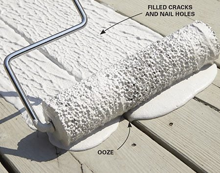 <b>Photo 2: Roll on the deck coating</b></br> <p>Dunk the entire roller in the pail, place it on the deck boards and press down to form a puddle. Then roll the puddle forward to force the product into the cracks. Then lift, reload and do the next section. Don't back-roll.</p>