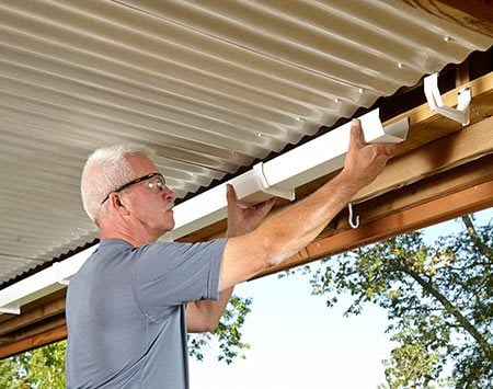 <b>Photo 3: Finish up with a gutter</b></br> <p>To keep rainwater from splashing onto the floor, Rune installed gutters along the beams. The gutters slope to a downspout at the end.</p>