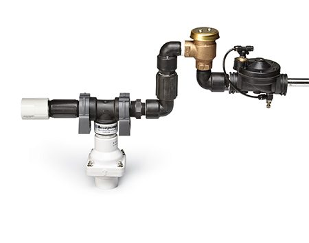 An above-sump backup pump is powered by water and sits high above the water in the sump basket.