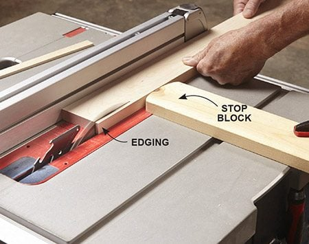 <b>Photo 1: Cut the edging safely</b></br> <p>Don't simply set the fence 3/16 in. from the blade to cut the edging strips. That can lead to kickbacks when the thin strips get pinched between the fence and the blade. Instead, clamp a stop block 3/16 in. from the blade. Set the stock against the stop block, position the fence against the stock and you're ready to rip. You'll need to reset the fence after each cut.</p>