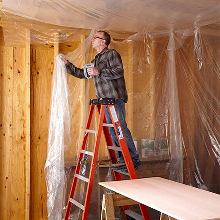 """<b>Tent the work area</b></br> <p>Open rafters and trusses are an endless source of falling dust. So if you're working under an open ceiling, hang plastic sheeting above. Keep the plastic at least 12 in. from light fixtures or remove the bulbs. Sometimes, adding plastic """"walls"""" is a lot easier than cleaning up the entire area. If you're using oil-based finishes, hang the sheets about a foot from the floor to allow for ventilation.</p>"""