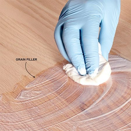 <b>Fill the grain</b></br> <p>The deep grain lines in woods like oak or walnut will telegraph through the clear finish, no matter how many coats you apply. And that's fine; it's part of the character of coarse-grain woods. But if a perfectly smooth surface is the look you want, use a grain filler. You'll find several products online or at woodworking stores. With most, you wipe on the filler, squeegee off the excess with a plastic putty knife and then sand after it's dry for a smooth-as-glass surface.</p>