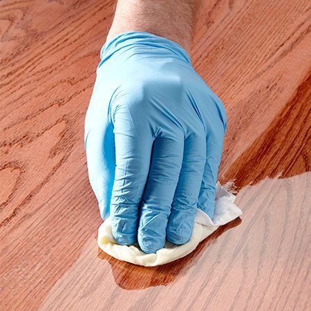 <b>Wipe on the final coats</b></br> <p>Wet-sanding leaves the surface perfectly smooth but dull. To restore the shine, apply two coats of wipe-on polyurethane (available in gloss, semigloss and satin). Wiping results in a very thin, fast-drying coat, so flaws like dust nubs or sags are less likely.</p>