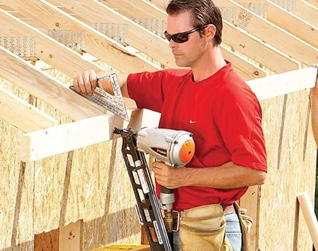 <b>Photo 14: Nail on the subfascia</b></br> <p>Align the subfascia with the tops of the trusses using any straightedge. Have a helper move the subfascia up or down as needed to get the right angle. Don't forget to run it long enough to meet up with the gable overhang later.</p>