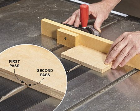 <b>Photo 2: Cut divider slots</b></br> <p>Mount a fence on your saw's miter gauge and position a stop block on the fence. Run the bin side across the blade. Then rotate the side 180 degrees and make a second pass to widen the slot. <b>Caution:</b> You have to remove the guard for this step. Be extra careful!</p>